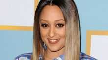 Tia Mowry Embraces Her Gray Hair in Glamorous Selfie