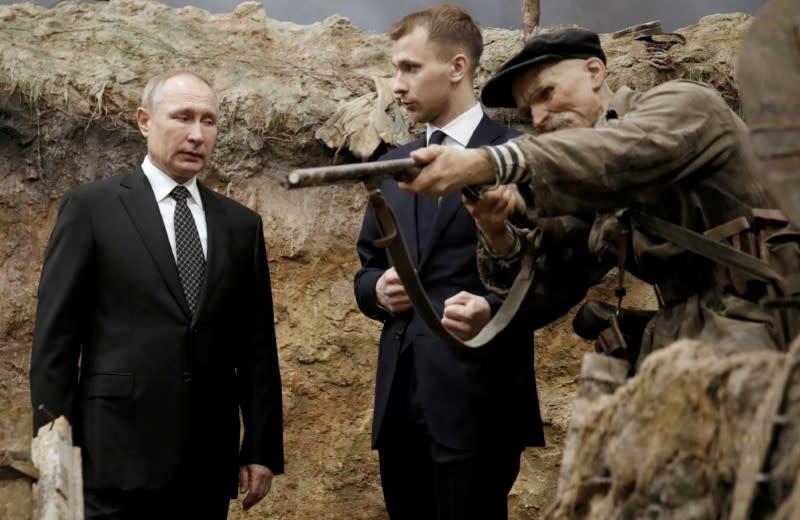 Russian President Vladimir Putin visits a 3D panorama 'Memory speaks. The road through the war' in St.Petersburg