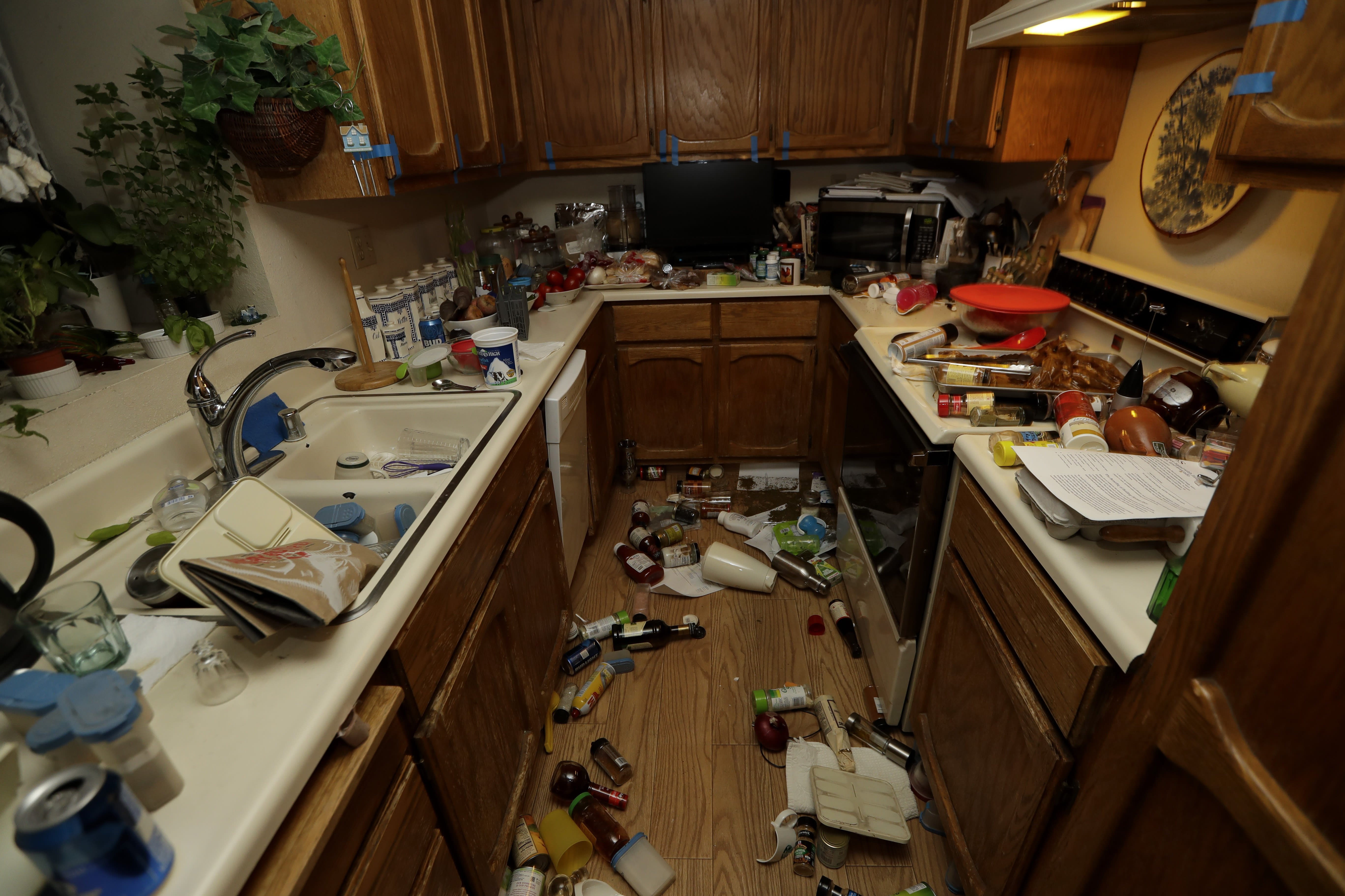 Items are scattered around a kitchen Saturday, July 6, 2019 following a earthquake in Ridgecrest, Calif. The Friday evening quake with a magnitude of about 7.1 jolted much of California, cracking buildings, setting fires, breaking roads and causing several injuries while seismologists warned that large aftershocks were expected to continue for days, if not weeks. ( AP Photo/Marcio Jose Sanchez)