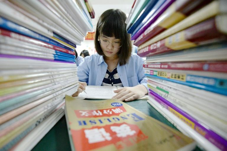 Zhejiang province has published a draft guideline proposing students go to bed at a decent hour - even if they still have unfinished schoolwork to do (AFP Photo/STR)