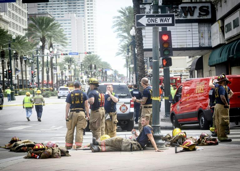 Emergency officials tend to the scene of a partial building collapse at the Hard Rock Hotel in New Orleans on October 12 (AFP Photo/Emily Kask)