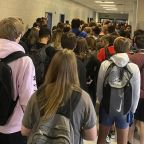 Pupils who shared photos of packed corridor of maskless Georgia students suspended