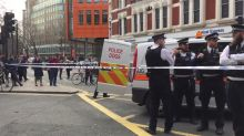 Police with dogs at scene of evacuated London building