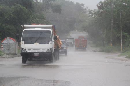 Cars drive through heavy rain after tropical storm Bret passed Margarita Island, Venezuela, June 20, 2017. REUTERS/Alexnys Vivas