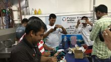 Singaporeans answer call to help foreign workers with donated phones