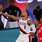 NBA roundup: Lillard scores 51, Embiid injured in Blazers' win