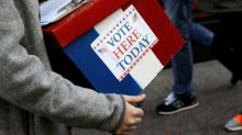 Three in Florida, Virginia charged with voter fraud