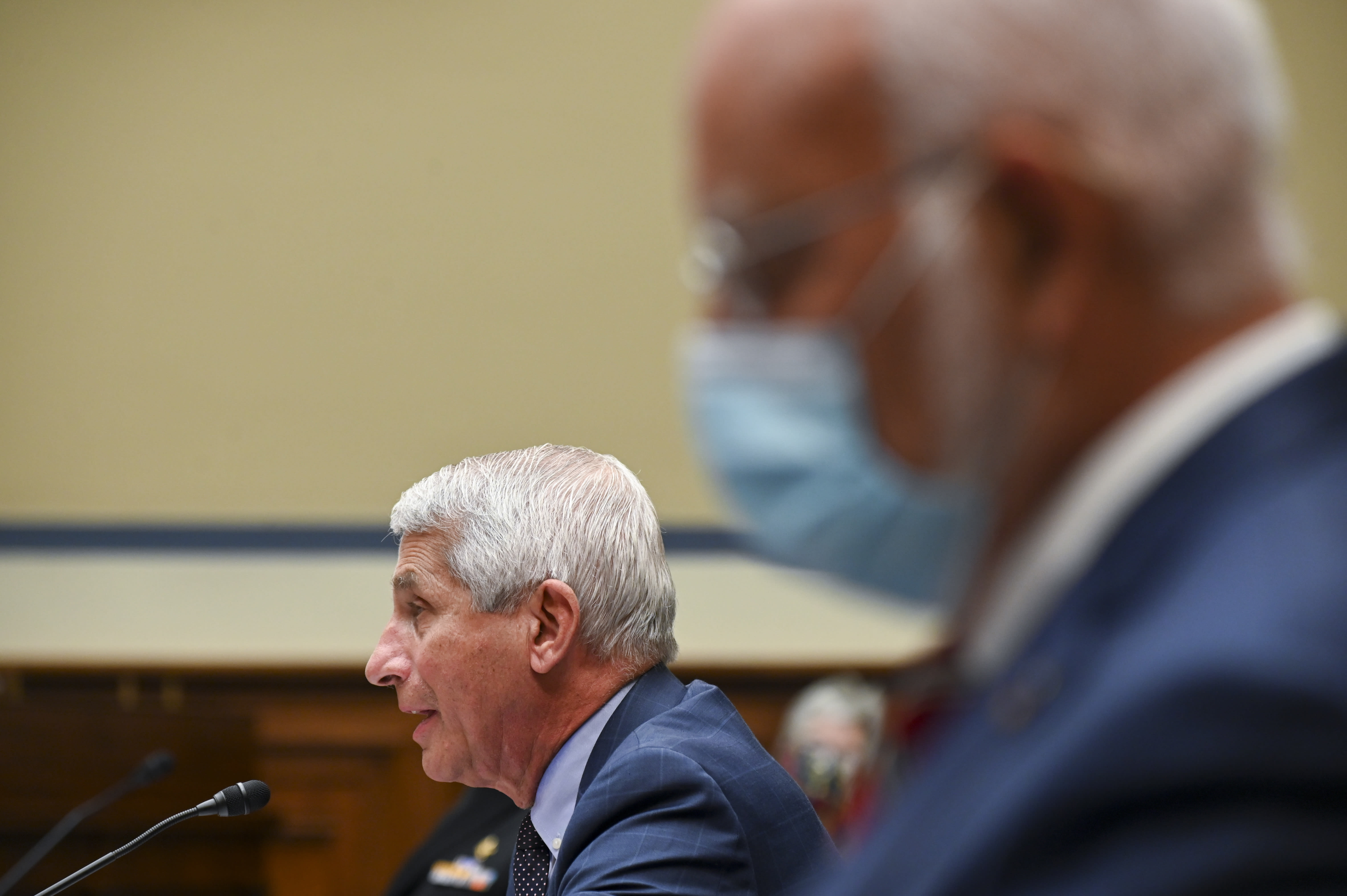 Dr. Anthony Fauci, director of the National Institute of Allergy and Infectious Diseases, speaks as Robert Redfield, director of the Centers for Disease Control and Prevention (CDC), right, listens during a House Select Subcommittee hearing on the Coronavirus, Friday, July 31, 2020 on Capitol Hill in Washington. (Erin Scott/Pool via AP)