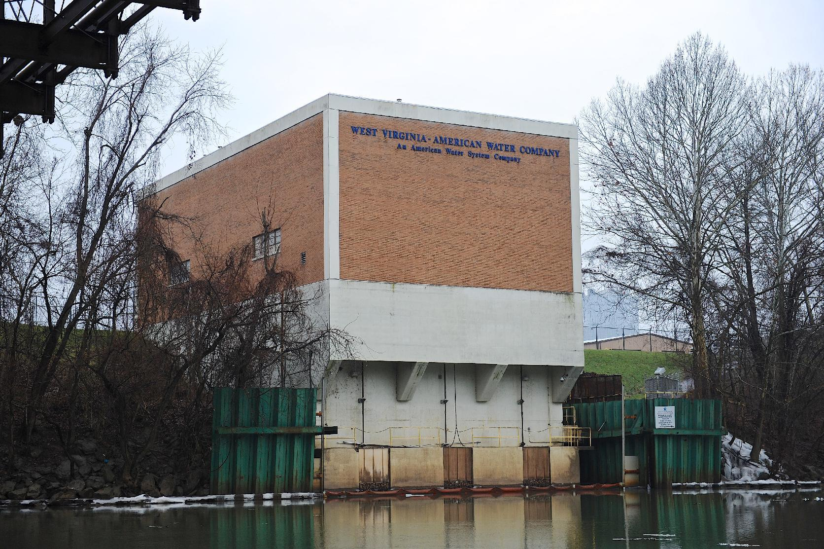 The West Virginia American Water Co. intake facility on the Elk River is closed following a 4-methylcyclohexane methanol leak from a 48,000-gallon tank at Freedom Industries, a chemical storage facility about a mile upriver in Charleston, W.Va., on Friday, Jan. 10, 2014. The White House has issued a federal disaster declaration in West Virginia, where a chemical spill that may have contaminated tap water has led officials to tell at least 300,000 people not to bathe, brush their teeth or wash their clothes. The West Virginia National Guard planned to distribute bottled drinking water to emergency services agencies in the nine affected counties. About 100,000 water customers, or 300,000 people total, were affected, state officials said. (AP Photo/Tyler Evert)