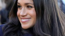 This new video of Meghan Markle playing with her dogs is a must-watch
