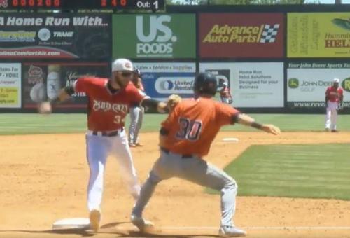 Carolina Mudcats third baseman Lucas Erceg tags out unsuspecting baserunner Kyle Tucker to complete the hidden-ball trick. (Mudcats on Twitter)
