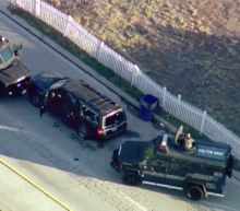 San Bernardino attack suspects shot up to 27 times