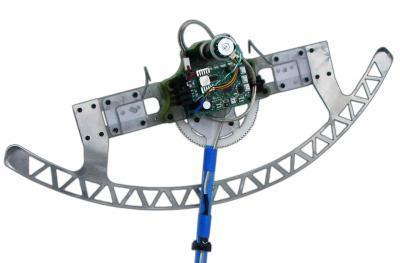 Robot equipped with hook-like claws and pendulum can climb carpeted walls