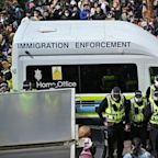 A huge crowd forced immigration officials to release two men detained in a van in Glasgow