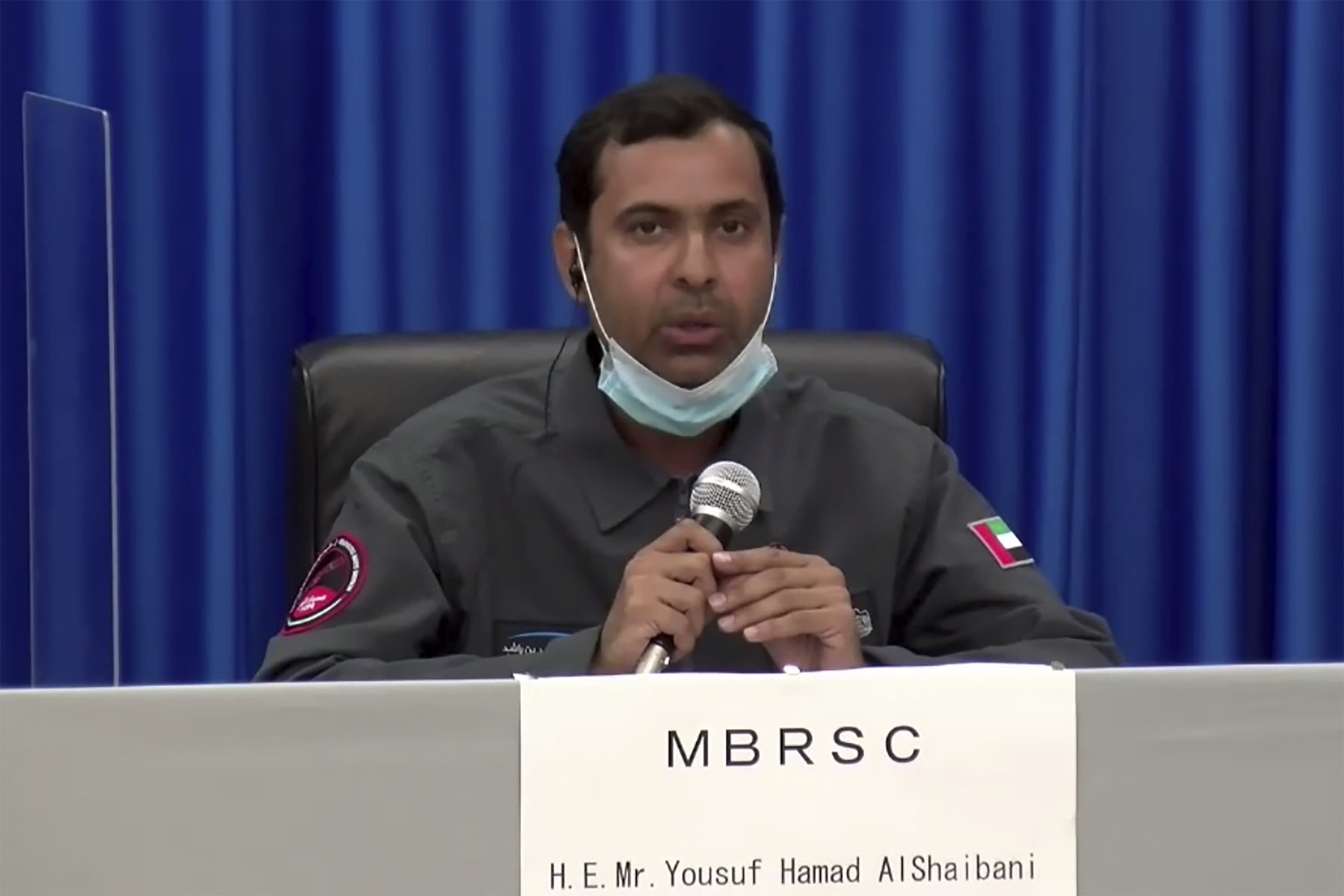In this image made from a video, Yousuf Hamad AlShaibani of Mohammed bin Rashid Space Center attends a news conference at Tanegashima Space Center on a small southern Japanese island after a launch of a United Arab Emirates spacecraft Monday, July 20, 2020. A United Arab Emirates spacecraft rocketed away Monday on a seven-month journey to Mars, kicking off the Arab world's first interplanetary mission. (MHI via AP Photo)