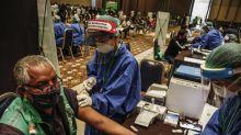 Grab drive-thru service to boost Indonesia vaccination campaign