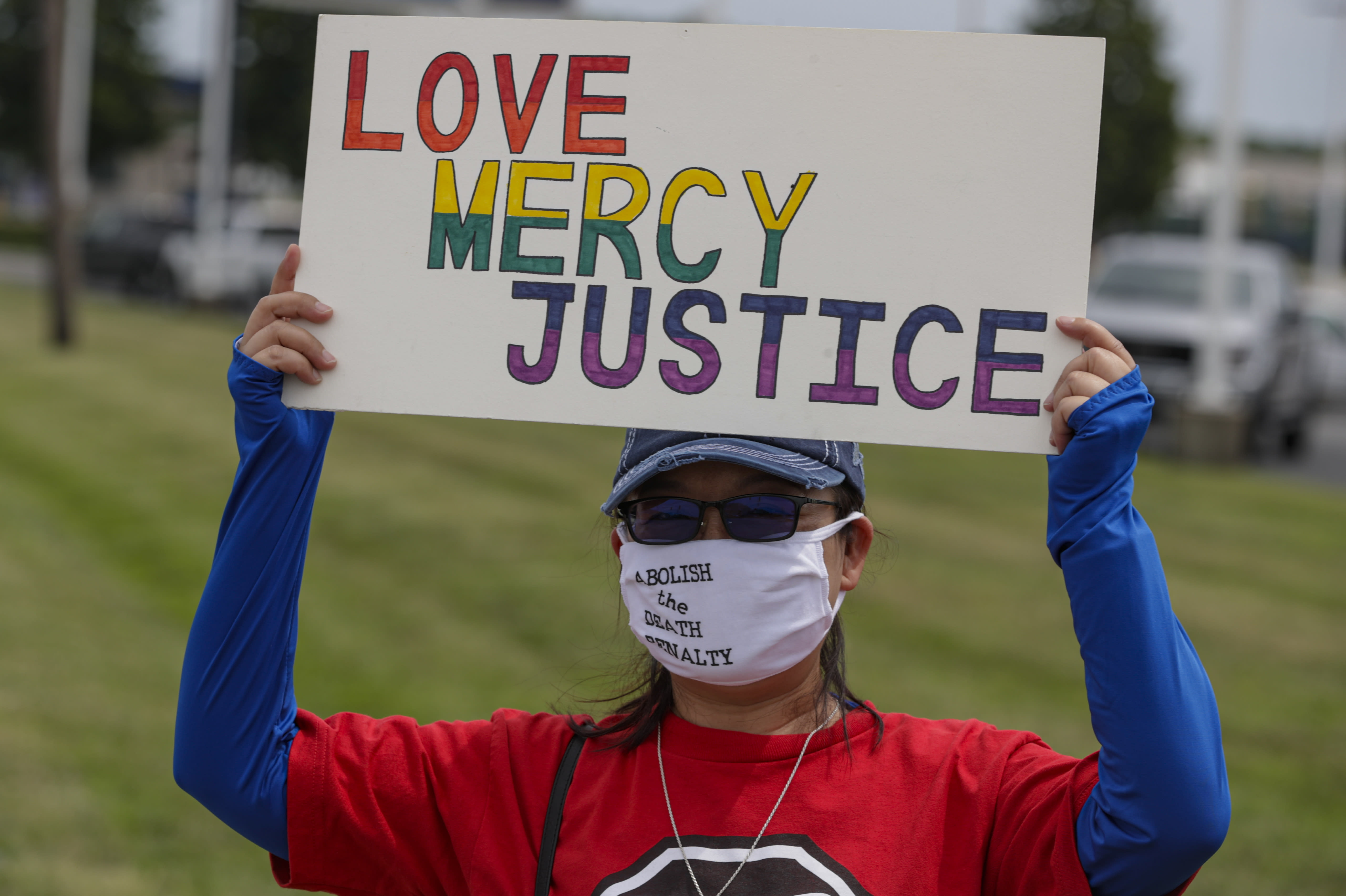 Protesters against the death penalty gather in Terre Haute, Ind., Wednesday, July 15, 2020. Wesley Ira Purkey, convicted of a gruesome 1998 kidnapping and killing, is scheduled to be executed Wednesday evening at the federal prison in Terre Haute. (AP Photo/Michael Conroy)