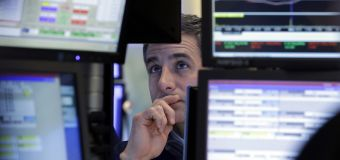 Wall St. lower after Fed takes hawkish stance