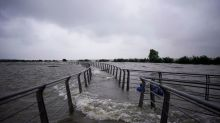 Residents at China's giant lake unfazed as rainfall breaks records