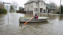 Montrealers hit by flooding using boats on city streets