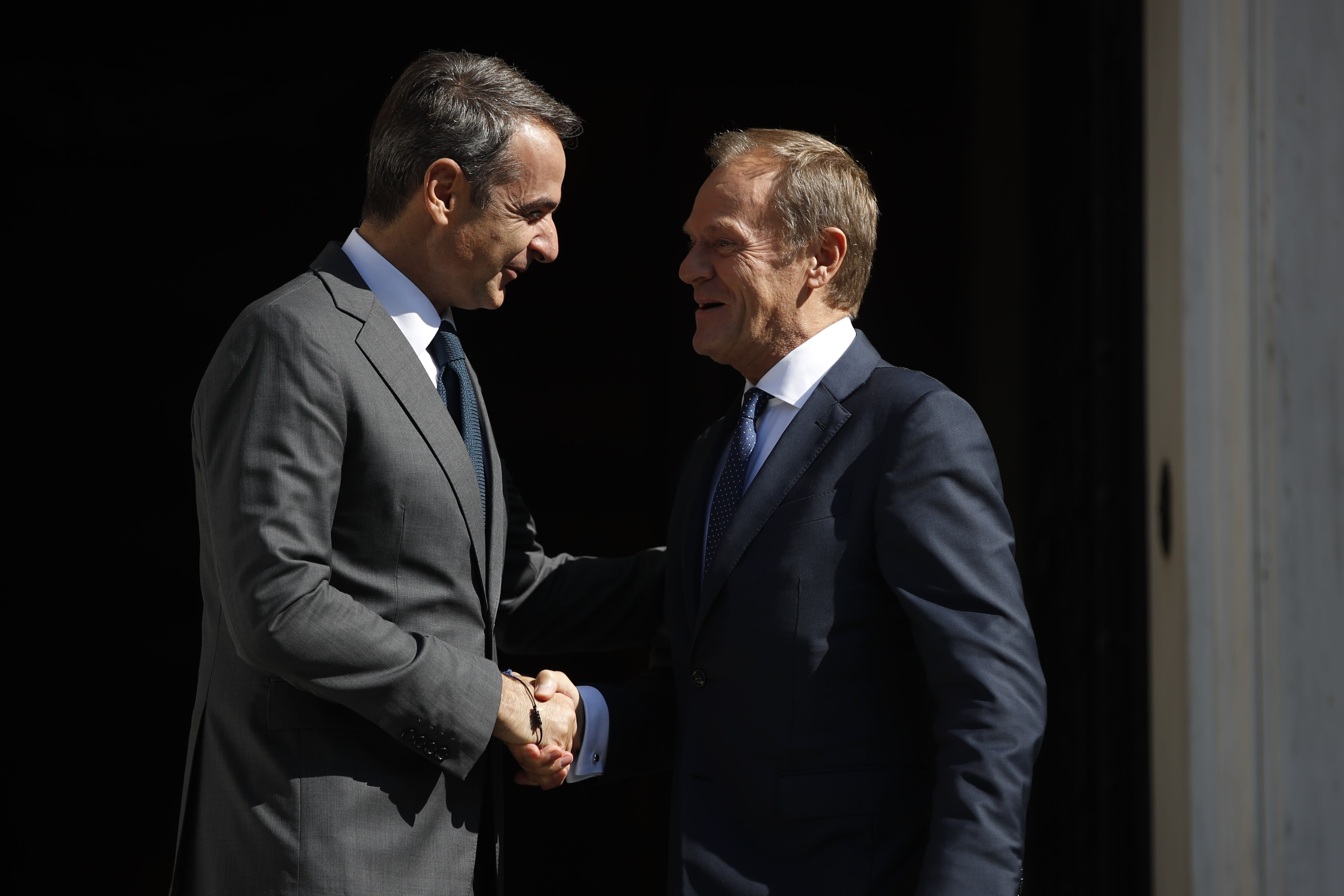 """Greece's Prime Minister Kyriakos Mitsotakis, left, welcomes the European Council President Donald Tusk during their metering at Maximos Mansion in Athens, Wednesday, Oct. 9, 2019. EU leaders have demanded more """"realism"""" from Britain in response to a Brexit plan proposed by British Prime Minister Boris Johnson. (AP Photo/Thanassis Stavrakis)"""