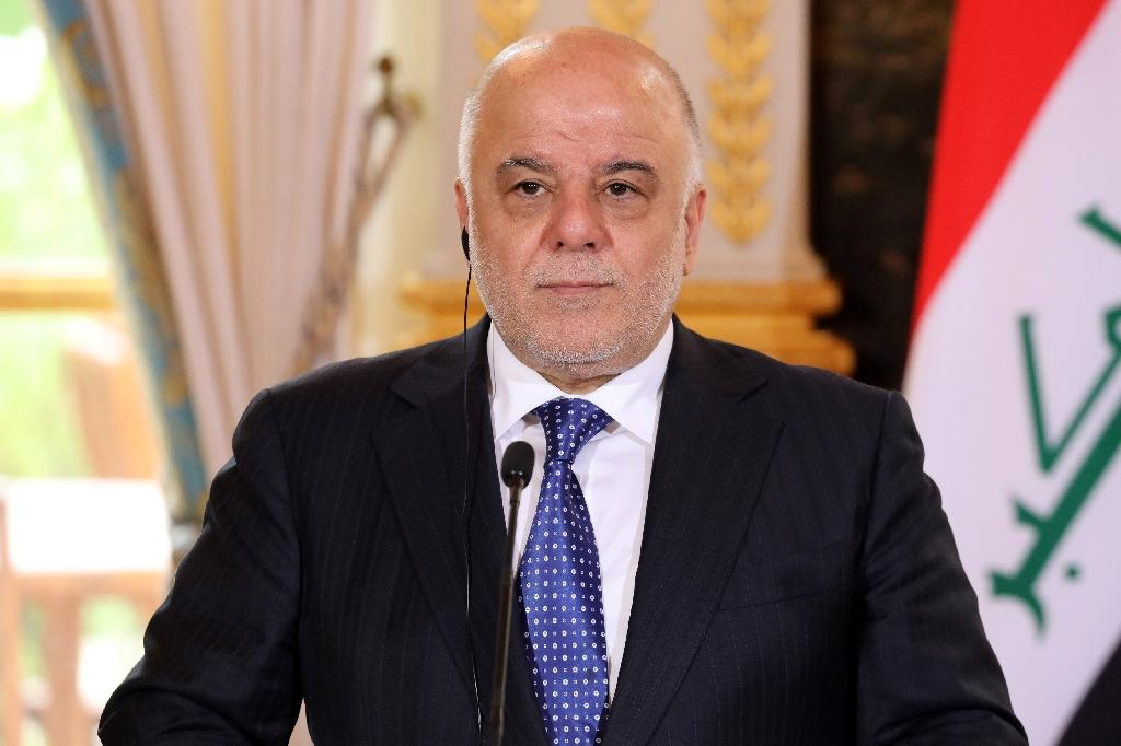 "Iraqi Prime Minister Haider al-Abadi, seen here in Paris in October. has announced ""the end of the war"" against the Islamic State group in Iraq"
