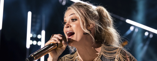 Carrie Underwood performs on stage during the CMA Music Festival. (AP)
