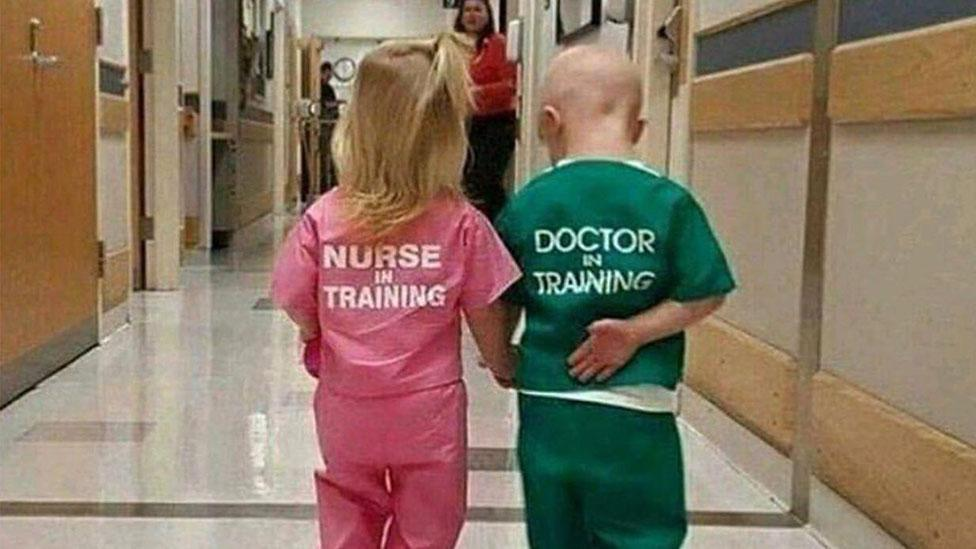 'Cute' hospital photo of two kids wearing scrubs branded 'sexist'