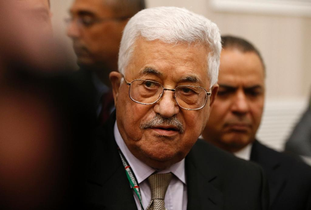 Palestinian president Mahmud Abbas (C) arrives to cast his vote at the Muqataa, the Palestinian Authority headquarters, in the city of Ramallah in the Israeli occupied West Bank, on December 3, 2016 (AFP Photo/AHMAD GHARABLI)