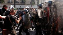 French police fire tear gas as 'yellow vest' protests return to Paris