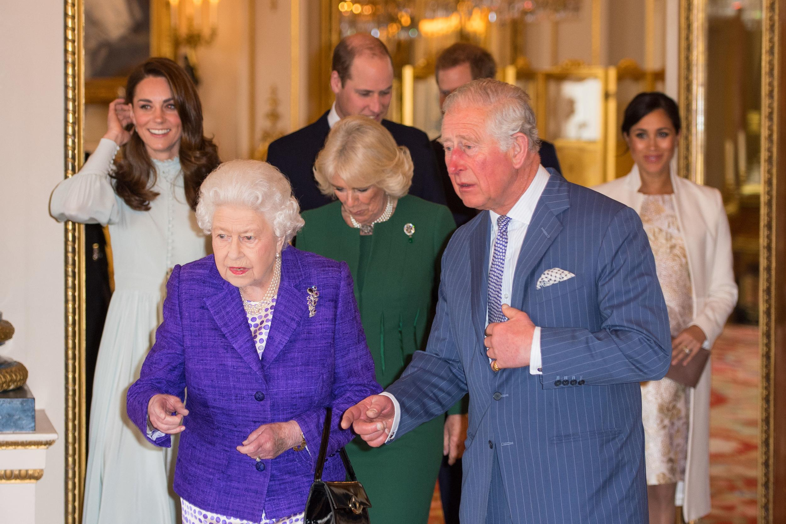 (L-R) Britain's Catherine, Duchess of Cambridge, Britain's Queen Elizabeth II, Britain's Prince William, Duke of Cambridge, Britain's Camilla, Duchess of Cornwall, Britain's Prince Charles, Prince of Wales, Britain's Prince Harry, Duke of Sussex, and Britain's Meghan, Duchess of Sussex attend a reception to mark the 50th Anniversary of the investiture of The Prince of Wales at Buckingham Palace in London on March 5, 2019. - The Queen hosted a reception to mark the Fiftieth Anniversary of the investiture of Britain's Prince Charles, her son, as the Prince of Wales. Prince Charles was created The Prince of Wales aged 9 on July 26th 1958 and was formally invested with the title by Her Majesty The Queen on July 1st 1969 at Caernarfon Castle. (Photo by Dominic Lipinski / POOL / AFP)        (Photo credit should read DOMINIC LIPINSKI/AFP/Getty Images)