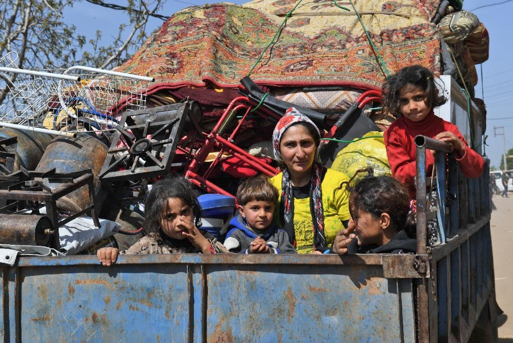 Civilians fleeing the city of Afrin in northern Syria on March 19, 2018