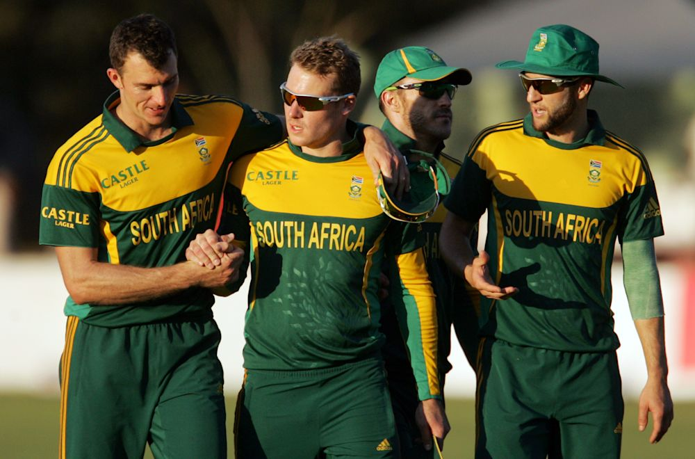 South African players celebrate during the second match of their three one-day international series against Zimbabwe at the Queens Sports Club in Bulawayo, on August 19, 2014