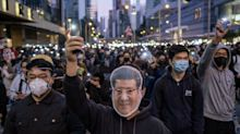 Hundreds of thousands march through Hong Kong in largest protest for weeks