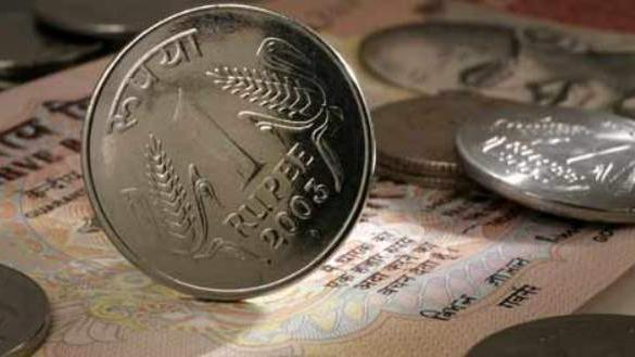 Rupee hits record low of 56.57 against US dollar