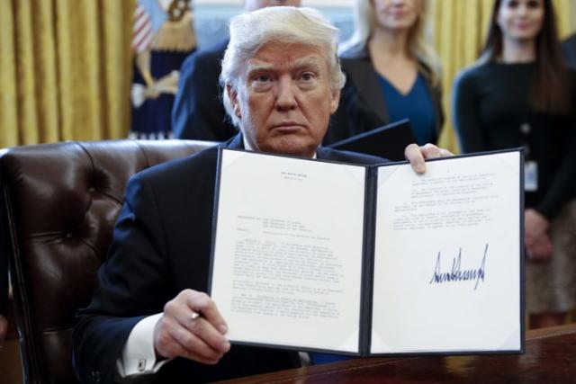 U.S. President Donald Trump is signing up a storm. Photo from Getty Images