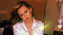 Here's Miley Cyrus In The Sparkliest Playsuit And Tallest Sparkly Boots
