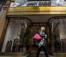 Michael Kors decides Jimmy Choo shoes fit the bill