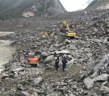 15 dead, scores missing hours after landslide buries Chinese village