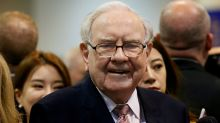 Berkshire says median employee makes over half Buffett's pay