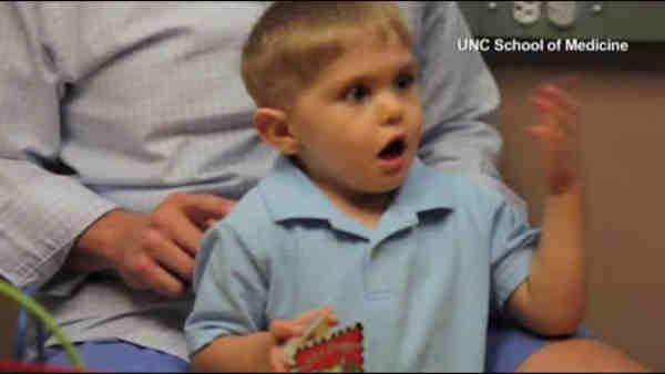 Little boy hears for first time after ear surgery