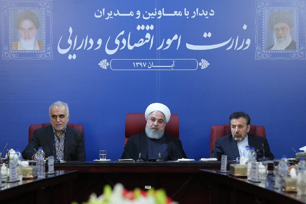 """Iran's President Hassan Rouhani (C), seen at a cabinet meeting in Tehran in a handout picture provided by the Iranian presidency on November 5, 2018, said the Islamic republic """"will proudly bypass sanctions"""" by the United States (AFP Photo/HO)"""