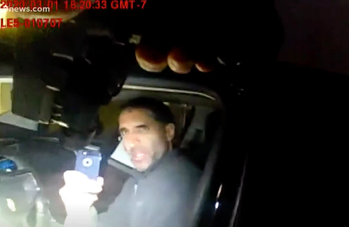 Officer points gun at doctor's head on his own property, cell phone video shows