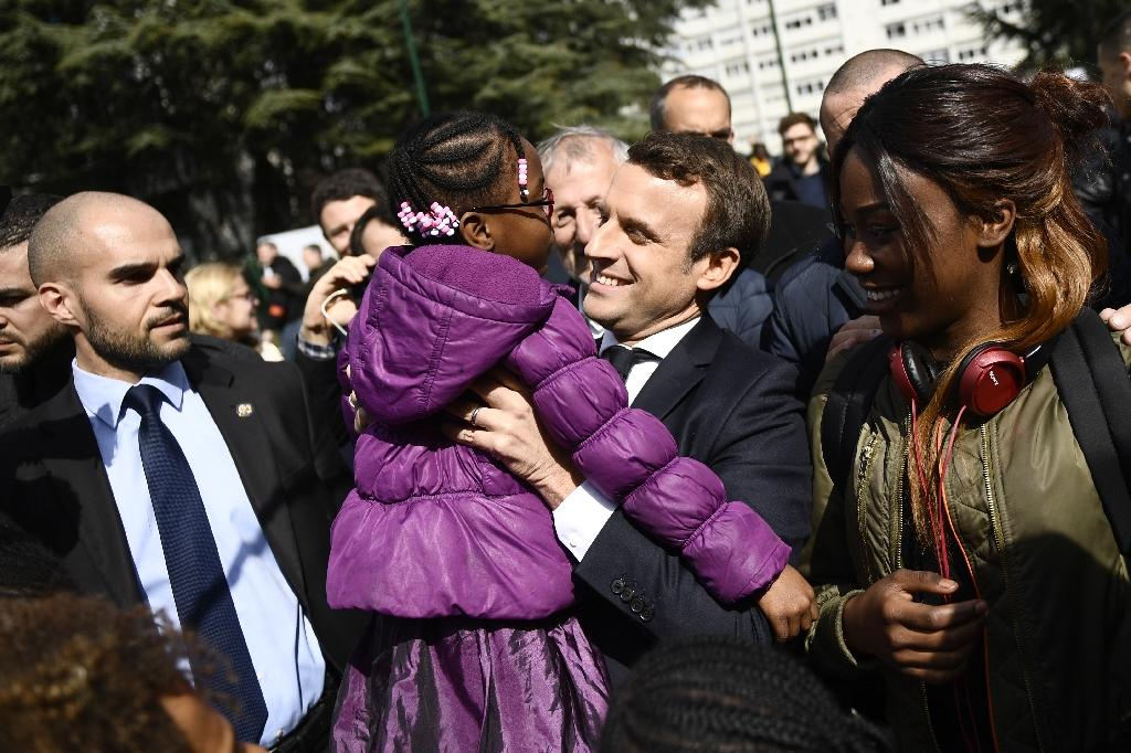 Emmanuel Macron believes improving social mobility is key to reducing the number of people living in poverty in France -- currently nine million (AFP Photo/Martin BUREAU)