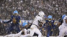 Army holds on in the snow to beat Navy 14-13