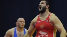 Olympic wrestlers tie for gold medal, 8 years after the competition
