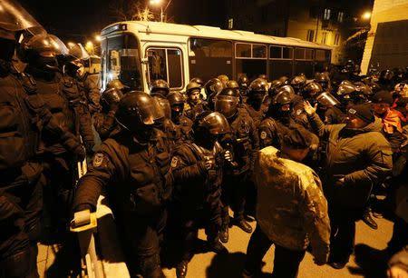Police officers block supporters of Georgian former President Mikheil Saakashvili near a temporary detention facility where Saakashvili was escorted after being detained in Kiev, Ukraine December 9, 2017. REUTERS/Valentyn Ogirenko