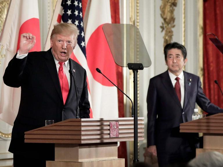 """Donald Trump has said he is unfazed by North Korea's recent short-range missile tests, putting him publicly at odds with Japanese prime minister Shinzo Abe who is hosting the US president on a state visit.The two leaders disagreed on the issue during a joint press conference designed to showcase US-Japan relations in Tokyo on Monday. Mr Abe, standing alongside Mr Trump following hours of talks, said Pyongyang's missile tests earlier this month violated UN Security Council resolutions and were """"of great regret"""".He added the missiles posed a security threat to Japan, which neighbours North Korea. But Mr Trump said: """"My people think it could have been a violation, as you know. I view it differently.""""North Korean leader Kim Jong-un is a """"smart man"""" who """"perhaps … wants to get attention"""", he suggested. """"Who knows? It doesn't matter,"""" the president added.Asked if he was """"bothered"""" by the missile tests, he replied: """"I'm not. I personally am not."""" Mr Trump sought to downplay the significance of the missile tests, despite his own national security adviser, John Bolton, saying last week there was """"no doubt"""" they had violated UN resolutions.North Korea's foreign ministry on Monday lashed out at Mr Bolton, whom a Pyongyang spokesperson described as """"more than ignorant"""" and """"a structurally defective guy"""".""""Our military drill neither targeted anyone nor endangered the surrounding countries, but Bolton makes dogged claims that it constitutes a violation of the 'resolutions', impudently poking his nose into other's internal matters,"""" North Korean state media quoted the spokesperson as saying.Mr Trump continues to hold out hope of persuading Mr Kim to relinquish his nuclear weapons and ballistic missiles, despite two rounds of talks with the North Korean leader breaking down with little progress.""""All I know is there have been no nuclear tests, no ballistic missiles going out, no long-range missiles going out, and I think that someday we'll have a deal,"""" the US president said during M"""
