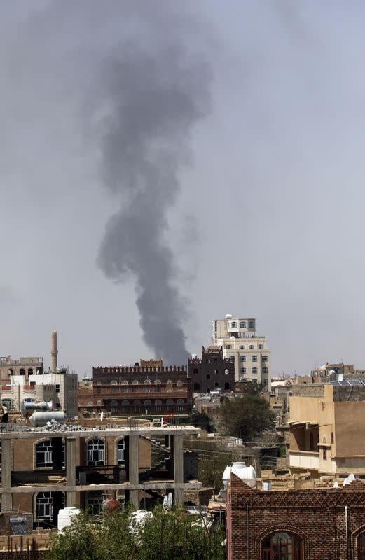 Smoke billows from the site of a Saudi-led air strike in Sanaa