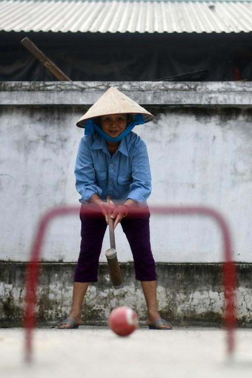 The seniors play with handmade metal and wood mallets and balls imported from China (AFP Photo/Manan VATSYAYANA)
